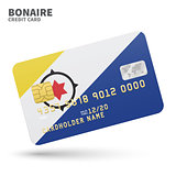 Credit card with Bonaire flag background for bank, presentations and business. Isolated on white