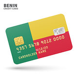 Credit card with Benin flag background for bank, presentations and business. Isolated on white