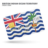 Credit card with British Indian Ocean Territory flag background for bank, presentations and business. Isolated on white