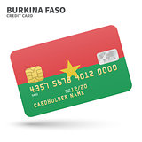 Credit card with Burkina Faso flag background for bank, presentations and business. Isolated on white