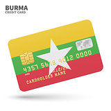 Credit card with Burma flag background for bank, presentations and business. Isolated on white