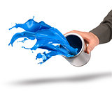 Hand throwing blue paint from can