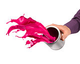 Hand throwing paint from can