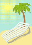 Sunbed under palm tree on tropical beach