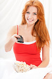 Girl watching movie with popcorn