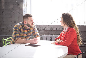Business meeting of man and woman in office
