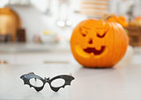 Closeup on halloween bat shaped glasses on table