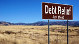 Debt Relief brown road sign