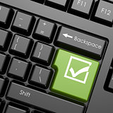 Green enter button with check mark on black keyboard, isolated