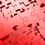 Red jigsaw puzzle with 3D effect