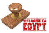 Red rubber stamp with welcome to Egypt