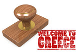 Red rubber stamp with welcome to Greece