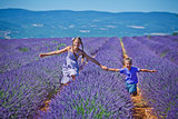 Kids in lavender summer field