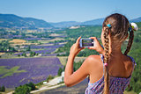 Girl taking photo lavender field