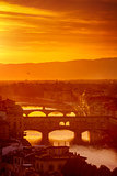Gold sunset at bridge Ponte Vecchio in Florence