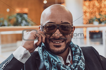 Arab businessman talking on mobile phone