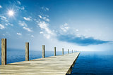 wooden jetty blue ocean