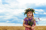 Cute little girl in summer wheat field