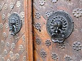 Iron lion knockers on a wooden door