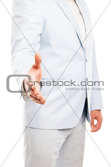 Close up of businessman hand extended to handshake isolated on white