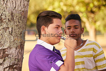Group of Teens Smokers Boy Smoking Electronic Cigarette