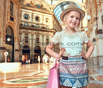 Portrait of happy fashion girl with shopping bag in Galleria