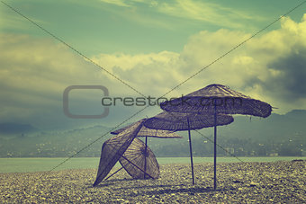 Old sunshade on deserted beach