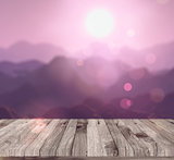 3D render of a wooden table looking to a mountain landscape