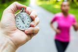Stopwatch Timer and Young Woman Running