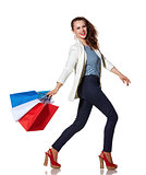 Smiling woman walking with French flag colours shopping bags