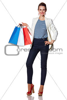 Portrait of smiling woman with French flag colours shopping bags