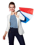 Portrait of happy woman with French flag colours shopping bags