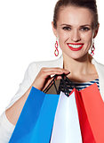 Close portrait of woman with French flag colours shopping bags