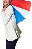 Closeup on happy woman with French flag colours shopping bags