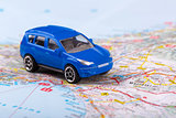 road trip, small toy car on map
