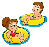 Children in swim rings image 1