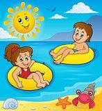 Children in swim rings image 2