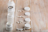 Various white plastic pill bottles and heap of drugs