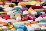 Pharmaceutical background of colorful pills and drugs