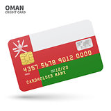 Credit card with Oman flag background for bank, presentations and business. Isolated on white