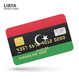 Credit card with Libya flag background for bank, presentations and business. Isolated on white