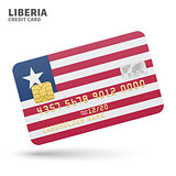 Credit card with Liberia flag background for bank, presentations and business. Isolated on white