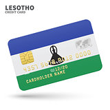 Credit card with Lesotho flag background for bank, presentations and business. Isolated on white