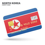 Credit card with North Korea flag background for bank, presentations and business. Isolated on white