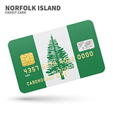 Credit card with Norfolk Island flag background for bank, presentations and business. Isolated on white