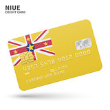 Credit card with Niue flag background for bank, presentations and business. Isolated on white