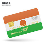 Credit card with Niger flag background for bank, presentations and business. Isolated on white