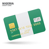 Credit card with Nigeria flag background for bank, presentations and business. Isolated on white