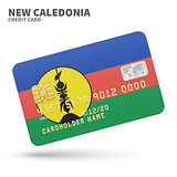 Credit card with New Caledonia flag background for bank, presentations and business. Isolated on white