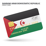Credit card with Sahrawi Arab Democratic Republic flag background for bank, presentations and business. Isolated on white